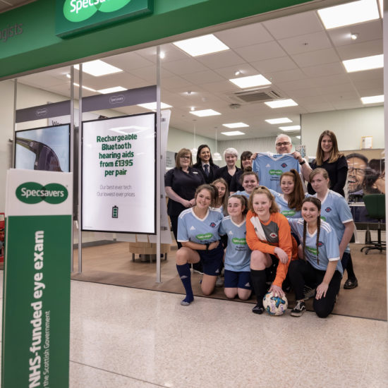 Specsavers Straiton with LMYFC U15 Girls in shop