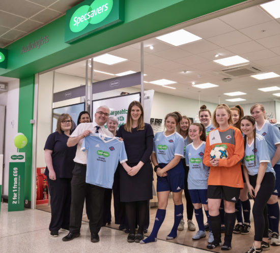 Specsavers Straiton with LMYFC U15 Girls outside shop